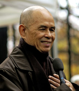 Image: Thich Nhat Hanh washes dishes.