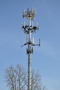 image: cell phone towers necessitate EMF Shield solutions.